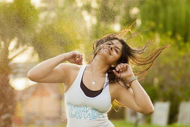 A woman throwing a ball